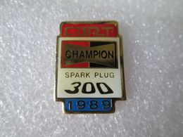 PIN'S    BOUGIE  CHAMPION   SPARG PLUG  300   CART  1989 - Badges