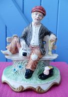 Statuette En Biscuit D'un Marin Sur Un Banc - Ceramics & Pottery