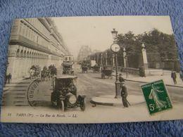 C.P.A.- Paris (75) - Rue De Rivoli - Autobus Automobiles Attelages Horloge - 1910 - SUP - (DE 22) - France