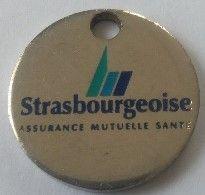 Jeton De Caddie -  Assurances - Strasbourgeoise - Assurance Mutuelle Santé - En Métal - - Jetons De Caddies