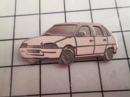 115d Pin's Pins / Rare & Belle Qualité !!! THEME AUTOMOBILES / CITROEN AX EN LEGER RELIEF - Citroën