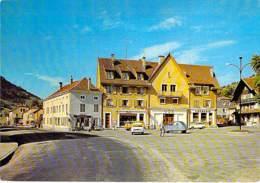 88 - Place De La Mairie Et La Rue Du 3 ème R.T.A ( Commerces Tabac Crèmerie Electricité ) CPSM CPM Grand Format - Vosges - Bussang