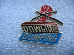 """Pin's Du Tampon Encreur """"DUMPING"""" - Pin's"""