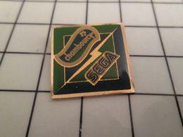 115d Pin's Pins / Rare & Belle Qualité !!! THEME JEUX / JEU DE CONSOLE SEGA YAOURT CHAMBOURCY - Jeux