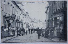 CPA LESSINES Grand Rue Très Animée Commerces Photographe Vêtements - Lessines