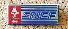 Pin's SNCF Train JEUX OLYMPIQUE ALBERVILLE 1992 SNCF - Métal - Peint Cloisonné - Fabricant COJO 1990 - Transportes