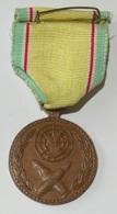 Militaria. Médaille. Décoration . Nations Unies.. Ruban Défraichi. - Belgique