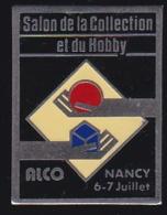 65827- Pin's-salon De La Collection Et Du Hobby.Nancy - Steden