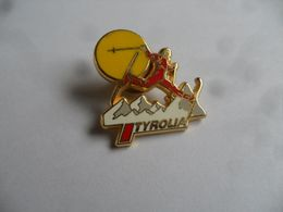 "(Pin's Arthus Bertrand - Sports D'hiver - Ski....) -  Fixations De Ski  "" TYROLIA""  .........voir Scans - Arthus Bertrand"