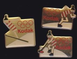 65866-Lot De 3 Pin's.Kodak.Photo.Jeux Olympiques. - Fotografía