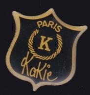 65877-Pin's.marque Kakie.Paris. - Marcas Registradas