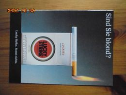 Carte Postale Publicitaire Allemand (Taschen 1996) 16,3 X 11,4 Cm - Lucky Strike. Sonst Nichts. Blond 1995 - Objets Publicitaires