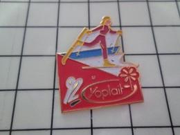 920 Pin's Pins / Beau Et Rare / THEME : JEUX OLYMPIQUES / YOPLAIT ALBERTVILLE 92 DANSE SUR SKIS ? Ou Autre ânerie Du Gen - Juegos Olímpicos