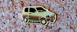 Pin's AIXAM - Verni époxy - Fabricant Inconnu - Pin's