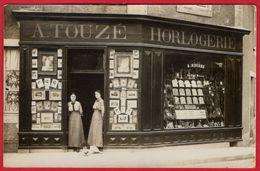 -- CHATEAUMEILLANT (Cher) - CARTE PHOTO / A. TOUZE HORLOGERIE / Place Saint Blaise -- - Châteaumeillant