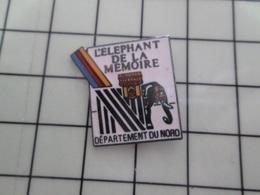 1320 Pin's Pins / Beau Et Rare / THEME : ANIMAUX / LILLE L'ELEPHANT DE LA MEMOIRE DEPARTEMENT DU NORD - Animales