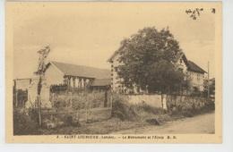 SAINT LOUBOUER - Le Monument Aux Morts Et L'Ecole - France