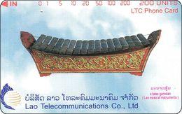 Laos Phonecard Tamura  A Bass Gamelan - One Punch - Laos