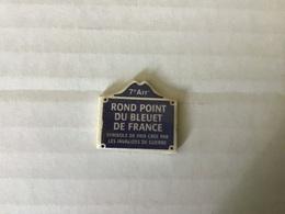 Fève Plate MH Moulin à Huile / PLAQUES DE RUE - ROND POINT DU BLEUET DE FRANCE  - PARIS 7eme - Regionen