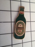 216A Pin's Pins / Beau Et Rare / THEME : BIERES / BOUTEILLE DE BIERE HEINEKEN PAR DRAGO - Bierpins