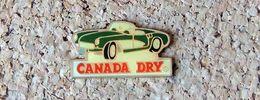 Pin's Chevrolet Corvette Cabriolet - Roadster Publicitaire Soda Canada Dry - Verni époxy - Fabricant Inconnu - Pin's & Anstecknadeln