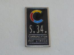 Pin's S.34.  COMMUNICATION PAR L IMAGE - Photographie