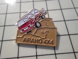 216c Pin's Pins / Beau Et Rare / THEME : AUTOMOBILES / ARAHO 4x4 DESERT SABLE - Pin