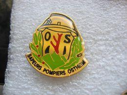 Pin's Des Sapeurs Pompiers De La Commune De OSTHEIM (Dépt 67) - Pompiers
