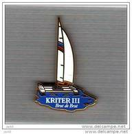 Pin's  Bateau  Voilier  KRITER III  Avec  Boisson  KRITER  Brut  De  Brut  ( ARTHUS  BERTRAND ) - Arthus Bertrand