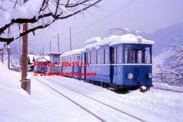 Reproduction Photographie D'un Train BVB Circulant Sous La Neige à Gryon En Suisse 1975 - Repro's
