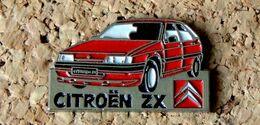 Pin's CITROËN ZX Rouge - Peint Cloisonné - Fabricant TOUL'EMBAL - Citroën