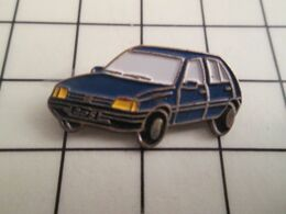 1115A Pins Pin's / Rare & Belle Qualité THEME AUTOMOBILES / PEUGEOT 205 BLEU DE FRANCE - Peugeot