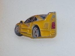 Pin's FERRARI, Signe ARTHUS BERTRAND, JAUNE - Ferrari