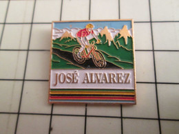 715e Pins Pin's / Rare & Belle Qualité THEME SPORTS / CYCLISME VTT JOSE ALVAREZ CHAMPION DU MONDE - Ciclismo