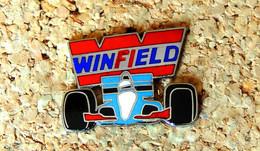 Pin's F1 Winfield Racing School TABAC Petit Défaut D'émail Sur Le F - EMAIL - Fabricant WINNER - F1
