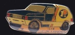 66808- Pin's.Rallye Automobile.Team E.Leclerc.R.Raymondis. - Rallye