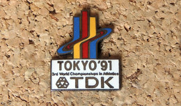 Pin's ATHLETISME- 3° Championnat Du Monde D'Athlétisme TOKYO 1991 Pub TDK - EMAIL - Fabricant TDK - Leichtathletik