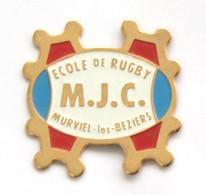 Pin's M.J.C. - Ecole De RUGBY - MURVIEL LES BEZIERS (34) - Ballon De Rugby - Croix Occitane - J662 - Rugby