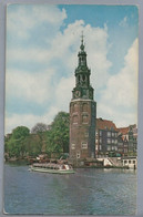 NL.- AMSTERDAM. MONTELBAANSTOREN AAN DE OUDESCHANS. RONDVAARTBOOT. - Monumenti