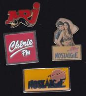 67021- Lot De 4 Pin's.Radio.médias...nostalgie.cherie.nrj.nostalgie. - Medien