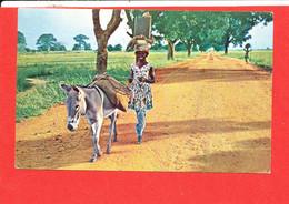 HAUTE VOLTA Cp Animée Une Femme Partant Au Marché Edit JAC - Burkina Faso