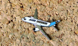 Pin's AVION - Compagnie Aérienne AIR INTER Jet - EMAIL - Fabricant PRIMOTOP - Aerei