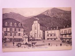 2020 - 7512  LARUNS  :  La Place Et L'Eglise   XXX - Laruns
