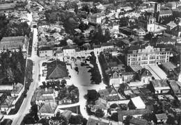 10 - Brienne Le Chateau - Vue Aérienne Sur La Palce;  La Halle Et Le Groupe Scolaire - Autres Communes