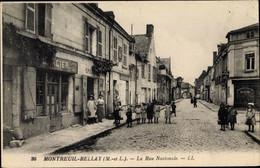 CPA Montreuil Bellay Maine Et Loire, La Rue Nationale - Sonstige Gemeinden