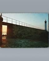 11- Aude - PORT LA NOUVELLE - Cpsm Gd Format Dentelée  - Lever De Soleil Sur La Jetée Et Le Phare - Port La Nouvelle