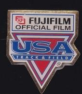 67460-Pin's.Fujifilm.USA Track Et Field.Photo.signé 36 USC 380 Aminco. - Photography