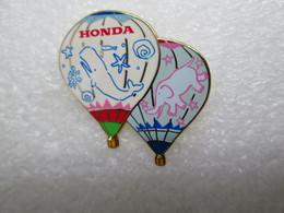 PIN'S   MONTGOLFIERE  BALLON    HONDA   Top Qualité Email  BALEINE  ELEPHANT - Montgolfier