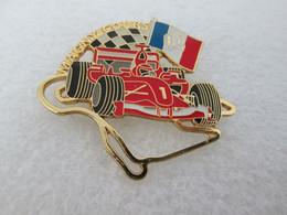 PIN'S FORMULE 1 FERRARI  GRAND PRIX DE FRANCE   MAGNY COURS  2004 M SCHUMACHER 40X35mm - Ferrari