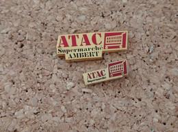 LOT DE 2 PINS MARQUE MAGASIN ATAC SUPERMARCHE AMBERT DONT 1 SIGNE BERAUDY VAURE - Trademarks
